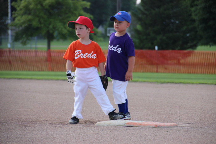 Breda Little League two kids staring